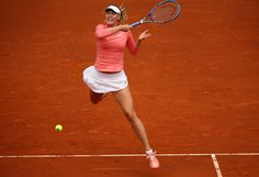 Mutua Madrid Open - Day Two - Maria Sharapova of Russia plays a forehand against Timea Bacsinszky of Switzerland in their second round match during day one of the Mutua Madrid Open tennis tournament at the Caja Magica on May 3, 2015 in Madrid, Spain.