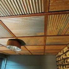 Rustic Steel Ceiling Tiles : Give your ceilings a vintage, rustic or industrial touch with corrugated steel tiles. Perfect for bars, industrial lofts, man caves and rustic-style eateries. Check out Dakota Tin today! Alter Do Chao, Metal Ceiling Tiles, Corrugated Tin Ceiling, Basement Ceiling Painted, Plywood Ceiling, Basement Ceilings, Basement Flooring, Laminate Flooring, Dropped Ceiling