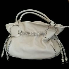 KOOBA LINEAV • Cream Color Handbag! LineAV by Kooba Cream Color Handbag EUC!  Braided detail and ties to change the look! Soft quality Italian leather. Large 14x18 size with 12x6 base, gold hardware, zipper top closure, includes strap to use crossbody! Needs some cleaning, has a few small marks.   🚫No Trades 🙄😘  🔘Use OFFER button to negotiate👍🤑 🔘Please Ask ❓'s BEFORE you Buy🤔😃 💕Thank you for stopping by! Happy Poshing!💕 Kooba Bags