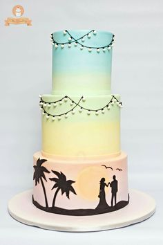 Pastel coloured sunset beach wedding cake                                                                                                                                                                                 More