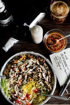 THE NEW YORK HALAL DRUNK FOOD - Chicken and lamb platter with yogurt/tahini sauce and chili oil.