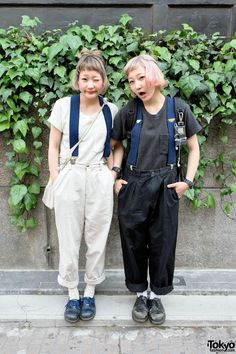 Nari & Naru are super-friendly resale-loving 19-year-old twin sisters who we have been seeing around Harajuku quite a lot recently. Their matching outfits here feature resale tops and resale rolled pants, suspenders, #Dr. #Martens shoes, and Casio G-shock watches. #tokyofashion #street snap #Harajuku