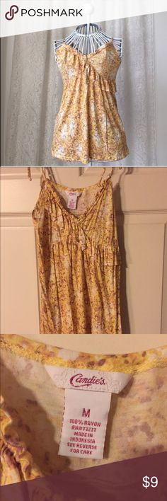 🌻Adorable Candies Tan Top Candies tank top with adjustable straps. Love the colors can be worn under a cute sweater or use in summer fun. I am reposting because it is too small 😢 Tag says medium but fits more like a small. Candie's Tops Tank Tops
