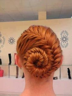 Fish tail bun. This is like Elsa's hair from Frozen before she transforms!!!!!