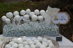 have cake pops displayed in blue candy for a boy's first communion #boy #firstcommunion