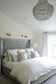 Serene Gray Master Bedroom With Elegant Chandelier