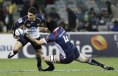 Matt Toomua of the Brumbies is tackled during the round 17 Super Rugby match between the Brumbies and the Rebels at Canberra Stadium on June 7, 2013 in Canberra, Australia.