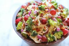 """Broccoli Salad - A healthy, hearty broccoli salad loaded with plump grapes and crunchy pecans tossed in a """"skinny"""" Greek yogurt dressing!"""