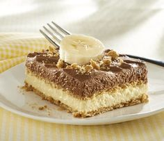 "Chocolate Banana Refrigerator ""Cake"": 1 pkg. (3.4 oz.) vanilla instant pudding mix, 3 c divided cold milk, 2 c divided thawed frozen whipped topping, 1 pkg. (3.9 oz.) chocolate instant pudding mix, 18 square honey grahams, 1 banana (cut into 24 slices)"
