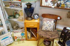 Vintage records with cool album art, Barkcloth pillows & Mid Century furniture.