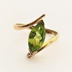 Modern Ladies Avante Garde Solitaire Peridot Marquise Ring in 9 ct Yellow Gold Band FREE POSTAGE Included by GloryBeVintageWares on Etsy