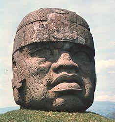 Ancient Mexico - The Civilizations of Ancient Mesoamerica.  A giant Olmec head of a warrior at La Venta
