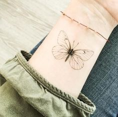 Minimal Butterfly tattoo