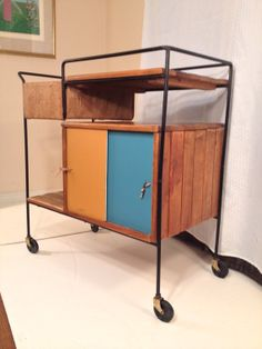 Don't like the look for us but good example of some closed storage and some open mid century modern Arthur Umanoff serving cart / by modmamavintage, $700.00