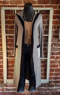Great cardigan for fall! The longer length makes it great for skinny jeans and dresses! Come by and get yours or order online here: http://8thstreetboutique.com/products/striped-maxi-cardigan