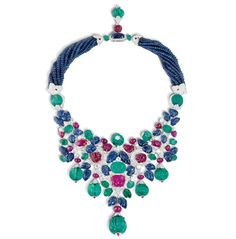 "The ""Hindu necklace"" commissioned by Daisy Fellowes in 1936. A flexible collar of rubies, emeralds, sapphires and diamonds set in platinum, with, in the center, a removable clip brooch composed of two huge sapphires."