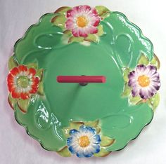 James Kent pottery floral cake plate - bakelite handle Vintage Cake Plates, Susie Cooper, China Art, Floral Cake, Vintage Country, Vintage Pottery, Plates And Bowls, Vintage China, Ceramic Pottery