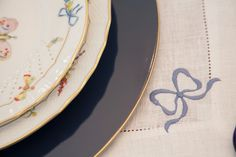 blue bow white table setting