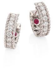 From the Symphony Collection. Braided white gold huggie style inset with diamond pave. Diamond, 0.21 tcw.18k white gold. Signature synthetic ruby detail at interior. Hinged post back. Made in Italy.