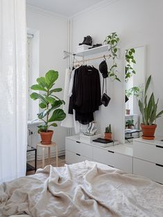 my scandinavian home: 10 Clever Small Space Tricks To Learn From a Lovely Swedish Apartment - bedroom storage and plants Scandinavian Apartment, Scandinavian Home, Bedroom Plants, Bedroom Decor, Bedroom Storage, Nordli Ikea, Decoration Photo, Narrow Rooms, Vintage Apartment