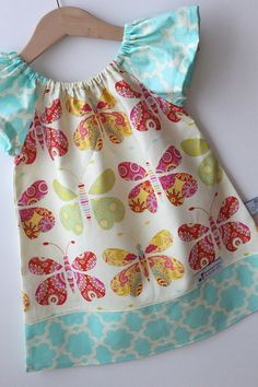 Love this for Ava-Flutter Sleeve Ruffle Peasant Dress in by SmashedPeasNCarrots, $34.00