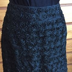 """Vintage Black Midi Pencil Skirt - Gorgeous Texture This true vintage skirt is absolutely spectacular & I wish that it still fit me!  Stunning texture - in the shape of roses.  Appears to be hundreds of grosgrain ribbons carefully seen down.  This is a VINTAGE size 12, which approximately equates to a Modern size 6. See Measurements to be sure!  Lying flat, Measures: Waist 14"""", Hips 18.5"""" & Length 25"""". Fully lined. Side zip. This garment has been professionally dry cleaned & is in excellent…"""