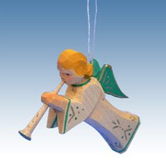 Trumpeting Angel Christmas ornament.  Hand-carved from the Emil Helbig Workshop, Erzgebirge, Germany.  Exquisite.  Available at www.mygrowingtraditions.com