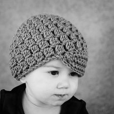 cute crochet hat! I wish I could follow a crochet pattern...who wants to help me?  lol