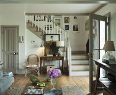 art in stairwell & portrait on table, trestle table with lower shelf, natural rug