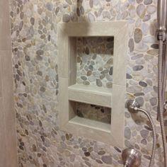 Pebble and travertine tile niche