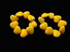 2 Yellow Plastic Heart Bead Expandables by HeartsMaddness on Etsy, $4.00