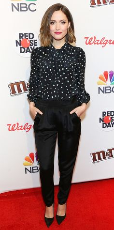 Rose Byrne in a printed blouse and black pants.