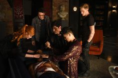 """SHADOWHUNTERS - """"Of Men and Angels"""" - Magnus and Luke reveal Clary's past in """"Of Men and Angels,"""" an all-new episode of """"Shadowhunters,"""" airing Tuesday, February 16th at 9:00 – 10:00 p.m., EST/PST on Freeform, the new name for ABC Family. (Freeform/John Medland) KATHERINE MCNAMARA, ALBERTO ROSENDE, ISAIAH MUSTAFA, MATTHEW DADDARIO, HARRY SHUM JR., DOMINIC SHERWOOD"""