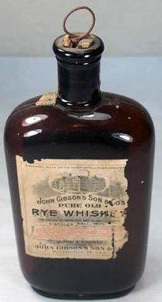 """Pure Old Rye Whiskey, from John Gibson's Son & Co. of Philadelphia, PA. The label reads: John Gibson's Son & Co's / Pure Old / Rye Whiskey / For the Use of Invalids and Connoisseurs / Distilled Fall 1893. It stands 8"""" tall."""