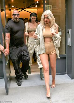 Shock factor:Kylie made sure all eyes were on her as she left her hotel with her older sister en route to the catwalk show with her new platinum blonde locks
