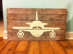 Pallet wood airplane art from BarnettBuilding on Etsy...excellent headboard potential!