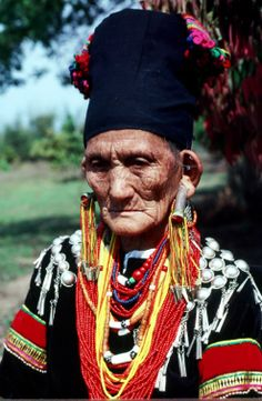 Asia   Portrait of aan elderly Lashi woman with earplugs, Myanmar   © Richard K Diran