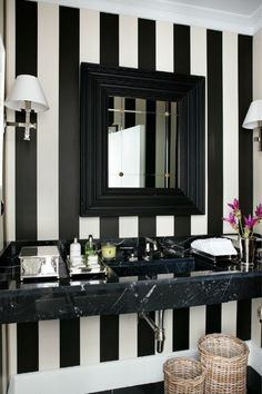 black and white striped - I like this idea for an accent wall in a living room or in a hallway, along w/ black and white family and pet photos