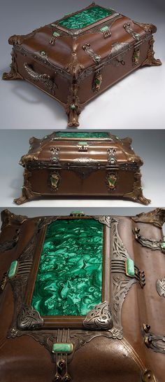 Vacklav Némec & Josef Ladislav Némec, Prague. Casket, c1900. H. 21 cm; 48 x 37 cm. Wooden body, covered with leather. Feet and fittings of bronze, handle silver-plated. Rich fittings of silver, engraved laurel leaves and bows, garnets and turquoises, cased malachite on the lid, front and back with coat-of-arms, gilded and enamelled. Secret compartment to the bottom of the lid. Silver marked: Dog's head (800), maker's mark V. N. Bronze parts marked: BRONZE, JL NEMEC.