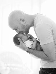Newborn photos-baby in basic onesie with daddy