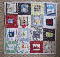 neat idea for baby clothes quilt. Border with scraps of the same outfit- or coordinating outfits