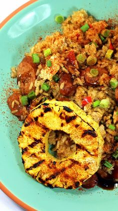 BEER Pineapple Jambalaya... Sweet-Heat and Savory... A new and amazingly DELICIOUS twist on the Cajun New Orleans Classic.  The rice absorbs the flavorful beer, while the Andouille Sausage is slow braised (also in beer).  layer upon layer of flavors.  Add HOT CAJUN spices and then cool off with a sweet pineapple piece and you are in N'Awlins HEAVEN!