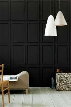 Black walls with white pendant lights