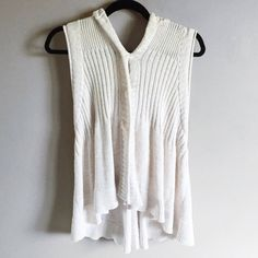 Free people sleeveless hooded sweater Free people sweater. Sleeveless and hooded. Very cute and also comfy. Has plastic button snaps In front, but can be worn unsnapped as more of a vest. It is and oatmeal/cream color and then a striped knitted pattern on the hood. In good used condition. It's a size small but could also fit a medium. ❌no trades. Free People Sweaters Cardigans