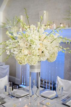 white hydrangea, roses and orchid tall centerpiece
