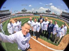 """In the middle of all the pomp and circumstance was probably the best selfie ever taken.  Check it out above.  From L to R: Kershaw (walking away), Newcombe, Valenzuela, Downing, Hershiser (holding camera), Russell, Cey, Magic, Wills, Koufax, Vin, Garvey, Lasorda, Monday.  Pic at the very top via Dodgers on twitter.    **  Dodgers Blue Heaven: Blog Kiosk: 4/13/2016 - Dodgers Links - First Glove, Raised """"LA"""" Logo and Vin Scully"""