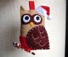 Pocket Felt Santa Owl- tan, crimson and red with Santa hat and Candy cane. $13.50, via Etsy.