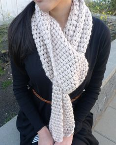 Crocheted puff stitch scarf:  3 Balls Bernat Satin yarn  Ch 26 work 12 puff stitches in the first row with ch-1's in between.  Then work twelve puff stitches in the chain-1 spaces.  Continue with this simple pattern for a couple more rows…  And then many more rows…  Until the scarf is desired length!