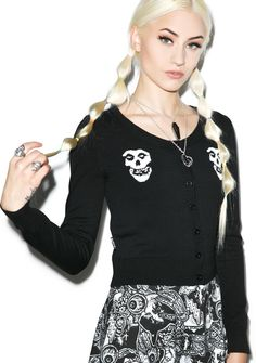 Iron Fist Misfits Cropped Cardigan Iron Fist Misfits Cropped Cardigan, whether you feel like rockin' out, or gettin' into trouble, this cardi has got ya covered. With mid torso cropped sweater features intarsia fiend skulls at the shoulders and button downs the front. With a round neckline with black buttons, and ribbed hems and cuffs, its perfect for layering over all yer most misfitting, and badazz pieces you've got.