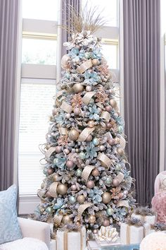 I wanted a tree that different and unique, so I combined two of my favorite colors ( blush & teal) to decorate my living room Christmas tree Christmas Tree Colour Scheme, Blue Christmas Tree Decorations, Elegant Christmas Trees, Christmas Tree Inspiration, Christmas Tree Design, Colorful Christmas Tree, Christmas Home, Turquoise Christmas, Modern Christmas